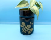 Upcycled self watering glass bottle planter with gold glitter bumble bee