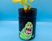 Self watering upcycled planter with Slimer