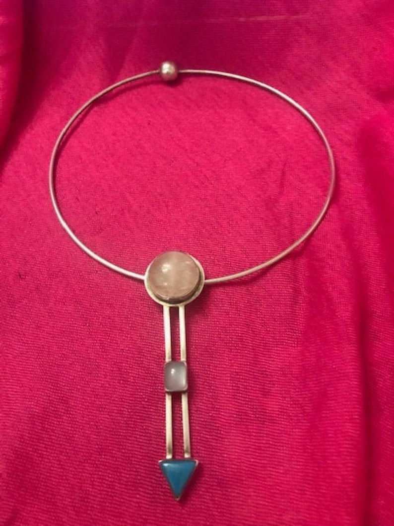 Sterling silver marked 925 Geometric pendant on a silver choker.