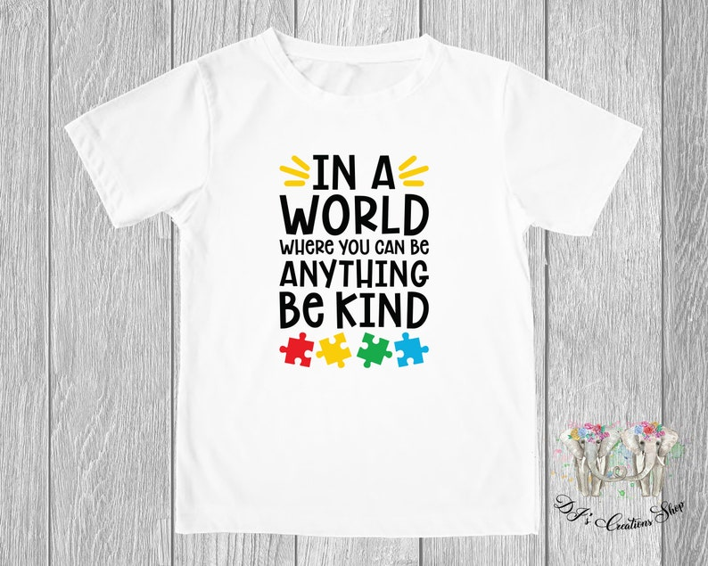 In a world where you can be anything be kind Onesie\u00ae In a world where you can be anything be kind Toddler T-shirt Autism Awareness