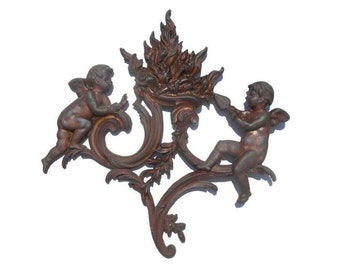 Antique cast iron cherubs tending the fire, French antique salvage piece from a fireplace screen