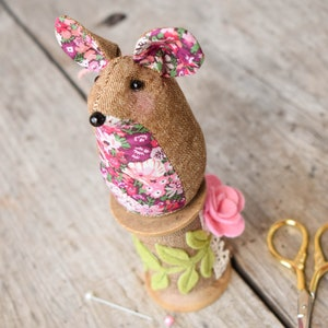 A cute sewing pattern featuring a needle roll and pincushion an ideal handmade gift. Liberty fabric and Essex linen Pinnie Mouse