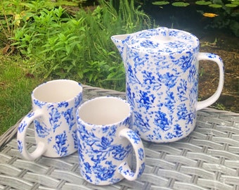 Set of two mugs and teapot. Hand painted bone china teapot with two hand painted china mugs.