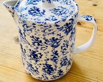 Hand painted bone china teapot.