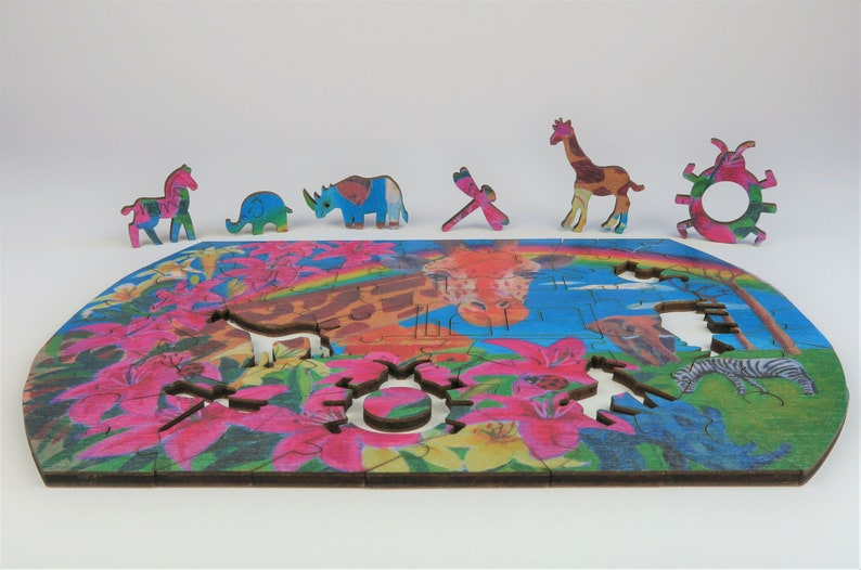 Wooden puzzle form earth Giraffe The beautiful abode image 0
