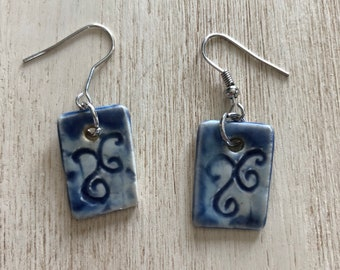 Handmade Blue earrings with carved scrolls