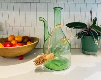 Green glass wine decanter chiller with ice pocket