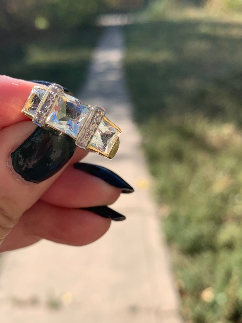 14k gold estate ring featuring square cut icy blue topaz colored stone and diamond accents