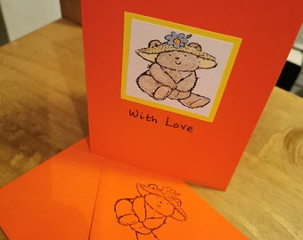 A6 red handstamped and pencil coloured With Love card featuring a teddy bear Envelope also handstamped.