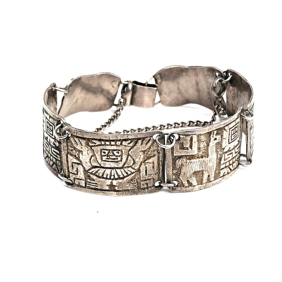 It is Most Likely Peruvian Vintage Rustically Made Sterling Cuff Bracelet with Condors and a God It is signed Inside But Not Clearly D16