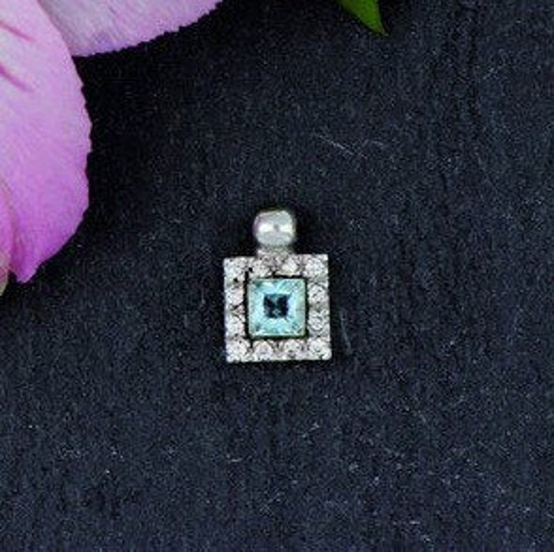 14K White Gold Pendant With Blue Topaz and CZ Stones