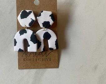 black + white cow print arch dangles // handmade polymer clay earrings