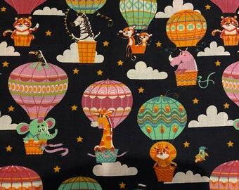Animals in hot air balloon polycotton fabric. Featuring lions, tigers, zebras, giraffes, elephants, monkeys, rhinos star