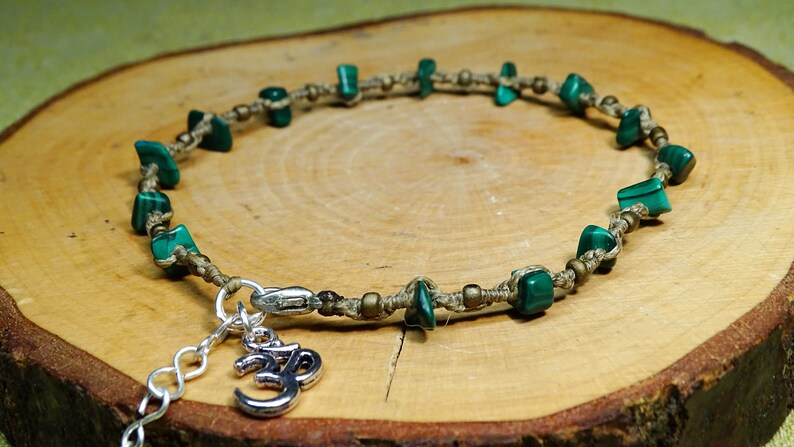 handmade macrame foot chain with semiprecious stone shards and om sign in beigelight brown anklet