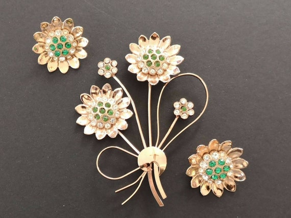 Corocraft scatter brooches.