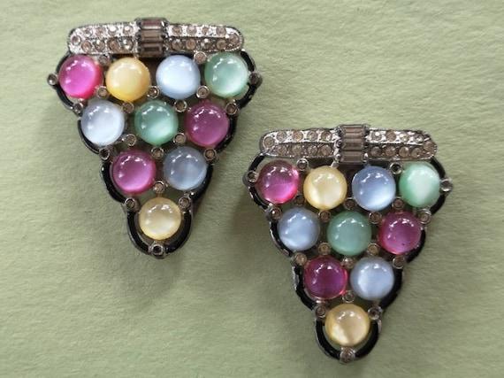 Art deco moonglow dress clips.