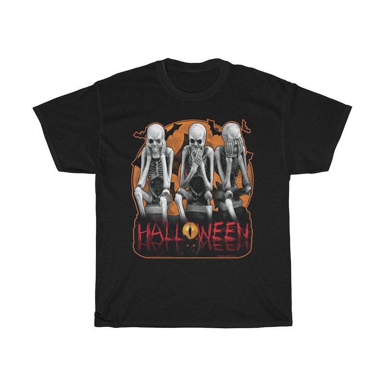 Eerie Halloween Skeletons 3 Tee. Printed in Black