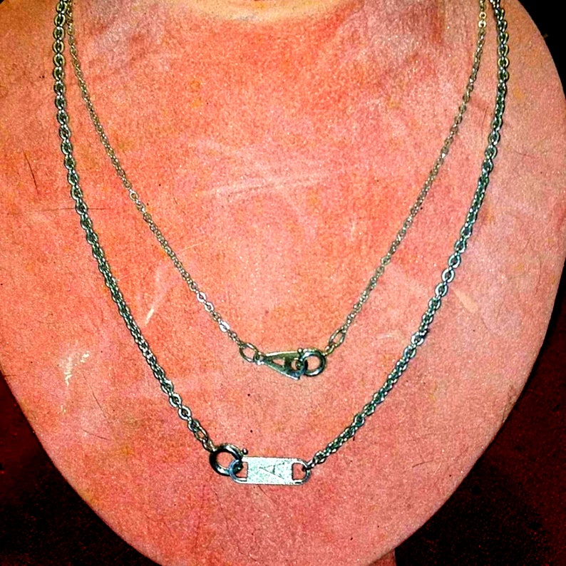 2 silver initial A necklaces