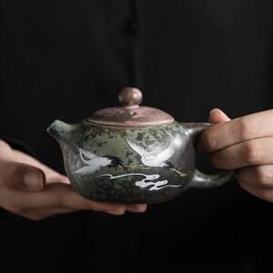 TANGPIN TEA-Black Crockery Ceramic Teapot Flying Crane Tea Pot