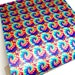 Chalani Martin reviewed Rainbow tie dye swirl printed faux leather sheet vinyl fabric craft supplies diy hair bows and earrings synthetic pattern leather