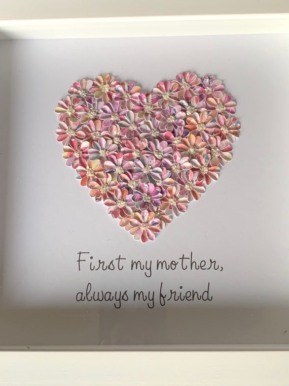 A bespoke heart made with small, delicate, handmade flowers with the words First my mother always my friends underneath