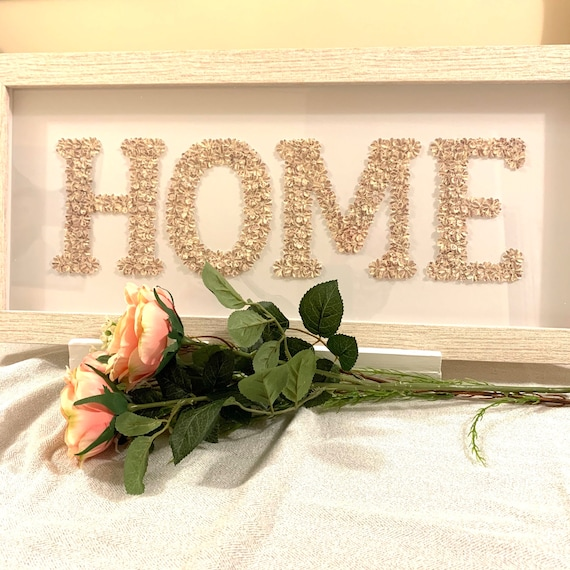 Home picture made with small, delicate, handmade flowers into the word home, then framed into a beautiful shabby chic frame