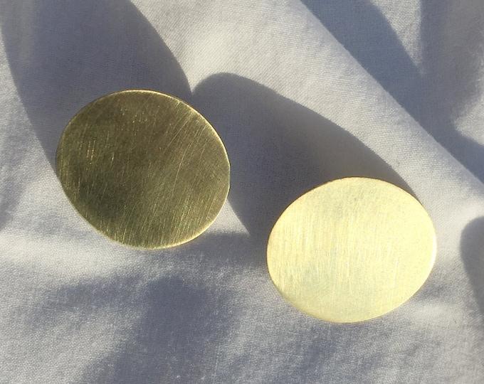 Nova modern circular brass studs