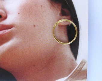 Large circle coil brass studs