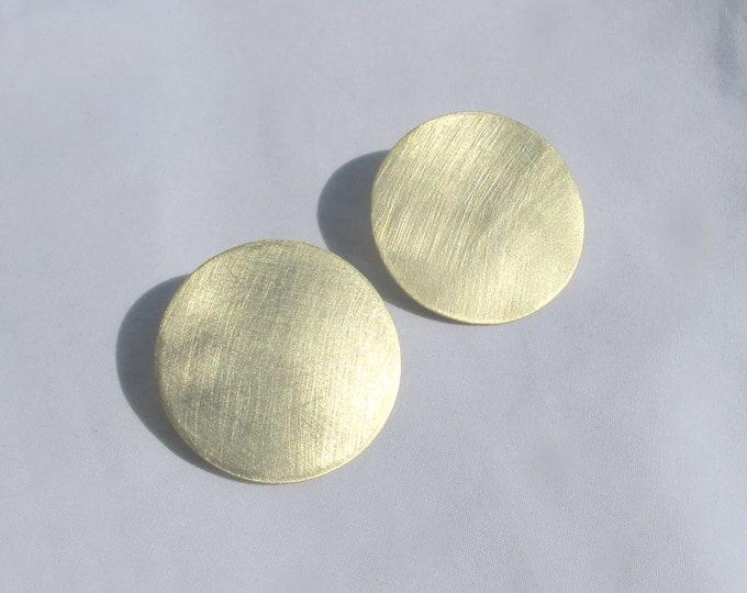 Womens modern circular brass studs