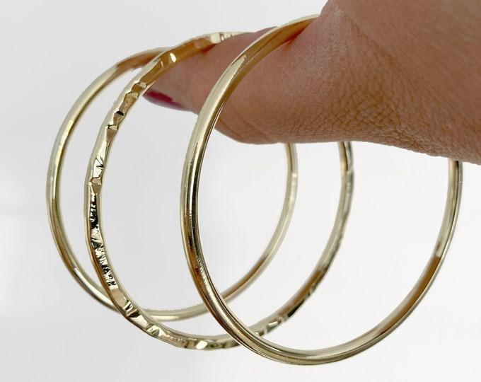 Trio of gold brass bangles