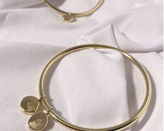 Womens gold bangle with sustainable token charm . Charm bangle . Recycled brass bangle. Gifts for her. Modern bangle. Mother's days gift.