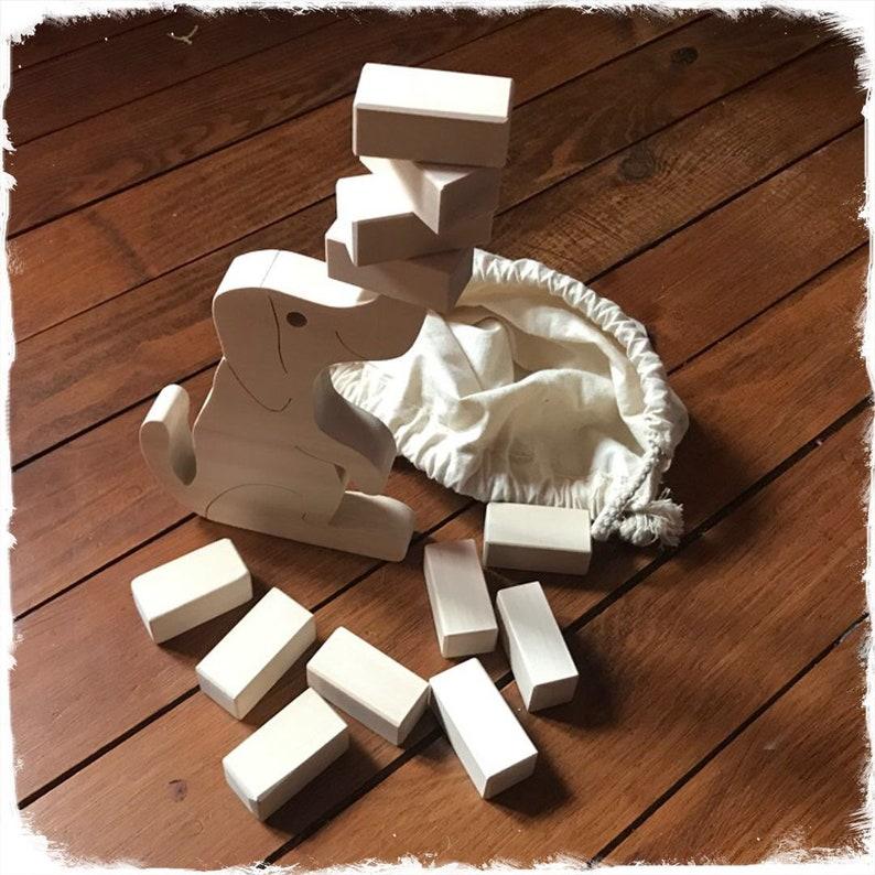 wooden toys dog balancing game and its sugars