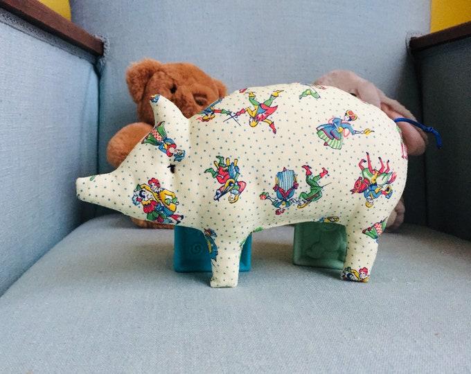 Hochet à grelot Petit Cochon nommé Vaillant