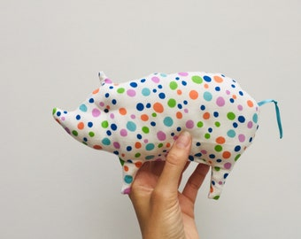 Baby rattles with bell, made of fabric, in the shape of a Little Pig