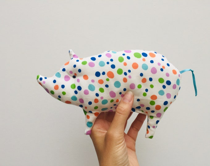 Baby rattles in the shape of a small pig, made of certified fabric, several models available