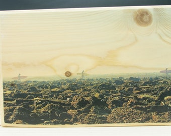 Photo on wood of Surfers in the Basque Country