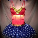 A hand made Wonder Woman Tramp Lamp