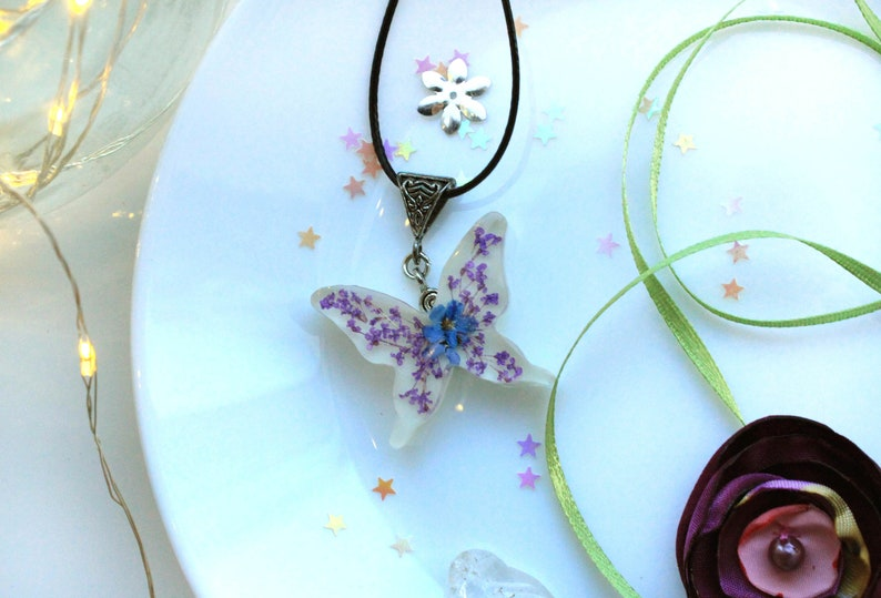 white resin butterfly pendant real dried flowers