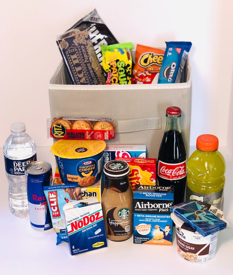 collapsible box filled with college student snacks and drinks to help a guy study for his final exams