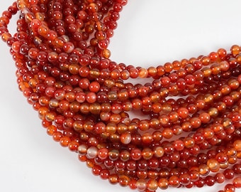 """Carnelian 6mm round beads, 15-16"""" strand, approximately 65 beads"""