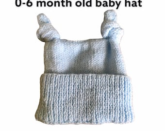 Hand knitted sparkly baby blue knotted teabag hat, size is 0-6 month old. Gift for baby. Gift for newborn, hats.