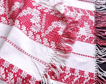 Linen tablecloth with red woven pattern and fringes