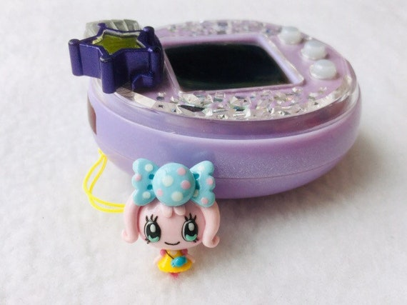 Candy Pakupaku inspired Tamagotchi charm 3d very detailed and realistic