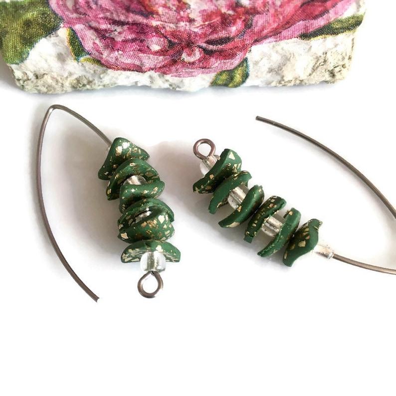 Trend hoops. Feminine creative jewelry Handmade earrings in fashion design