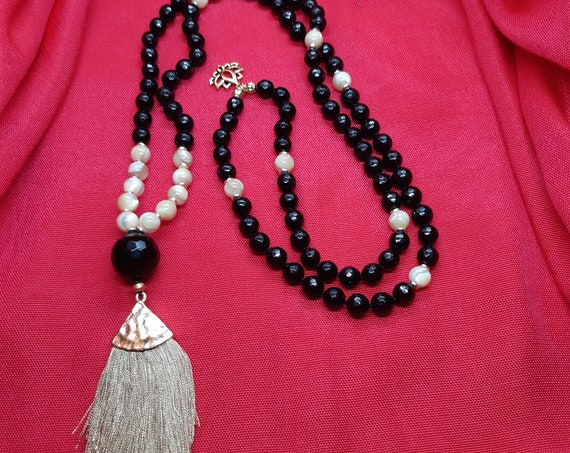 Black tourmaline faceted 108 beads Japa Mala and golden mother of pearl, tassel