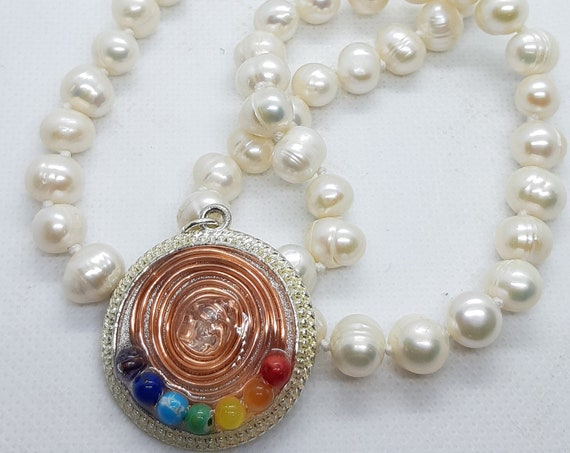 Natural pearl necklace with copper spiral pendant, white quartz and seven chakras.