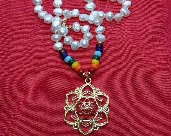 Natural pearl necklace, handmade with Czech glass beads with the colors of 7 chakras and symbol of the seed of life