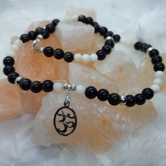 Necklace with obsidian beads, mother of pearl and OM symbol