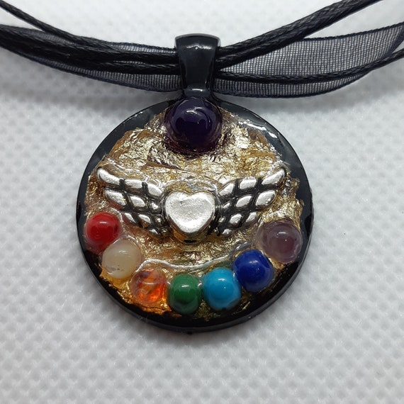 Orgone pendant with 7 chakras and angel wings