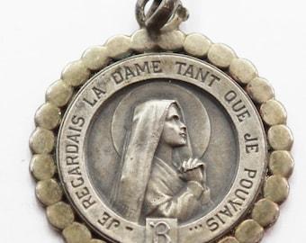 Rare saint bernadette medal